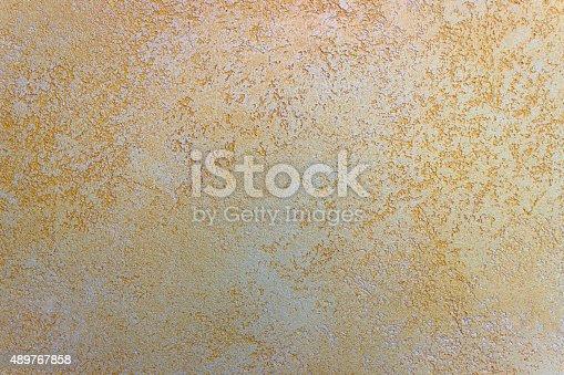 489767858istockphoto Wall texture Travertine orange Paint background. 489767858