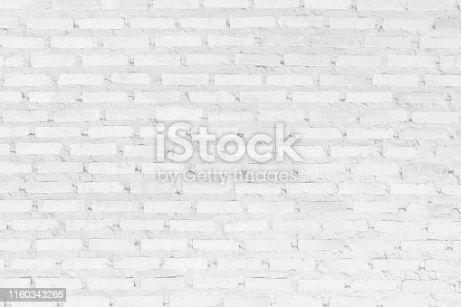 Wall white brick wall texture background. Brickwork or stonework flooring interior rock old pattern clean concrete grid uneven bricks design stack. Copy space with construction.