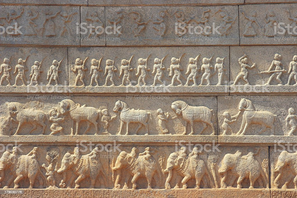 Wall with a carved relief: the Indian army royalty-free stock photo