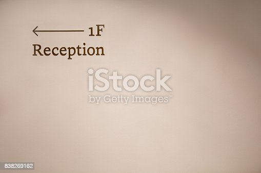 istock Wall with a reception arrow. 838269162