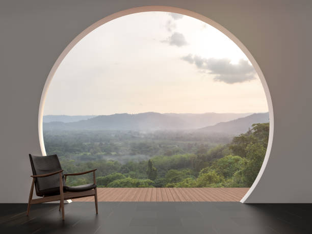 A wall with arch shape gap looking out over the mountains 3d render stock photo