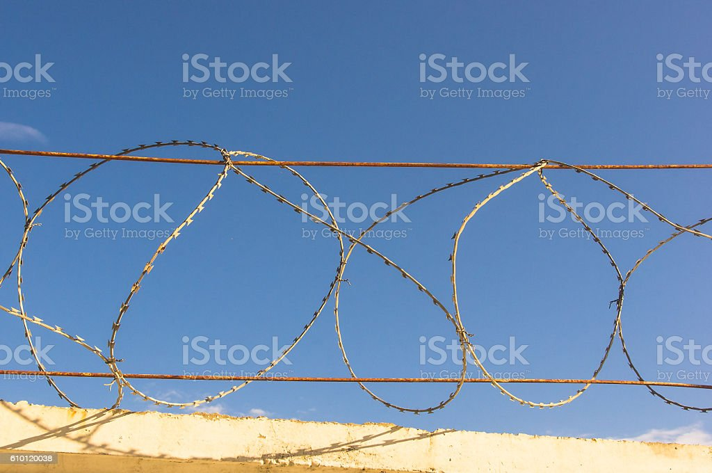 wall with barbed wire stock photo