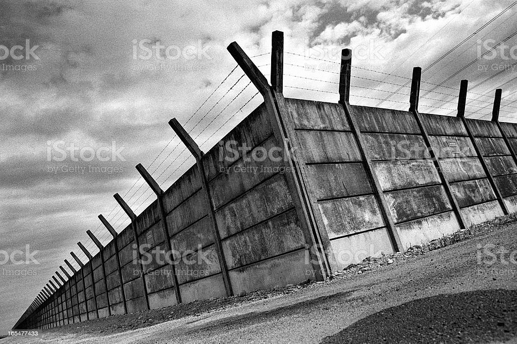 Wall with barbed wires royalty-free stock photo