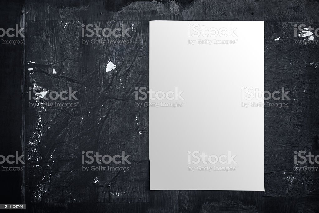 Wall with blank poster and torn posters - empty banner ready for your...