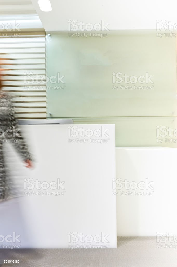 Wall with blurred person abstract image stock photo