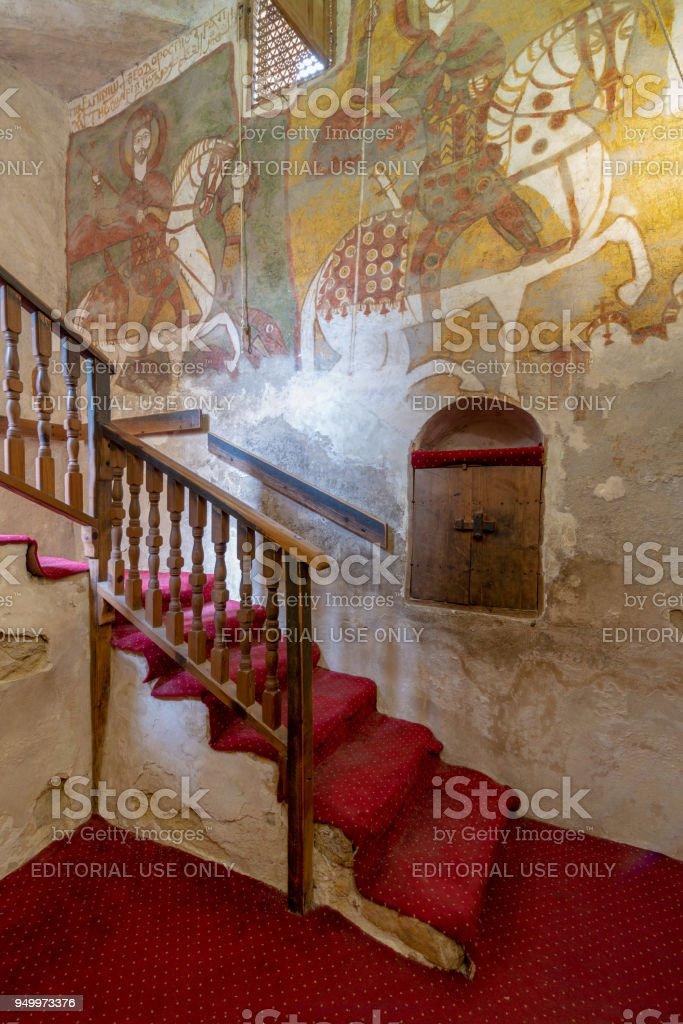 Wall with Coptic fresco paintings and staircase leading to the Church of St. Paul & St. Mercurius, Monastery of Saint Paul the Anchorite (aka Monastery of the Tigers), Egypt stock photo