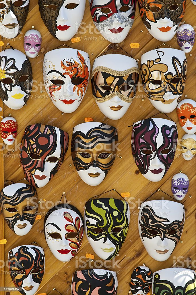 Wall with different size and colored masks royalty-free stock photo