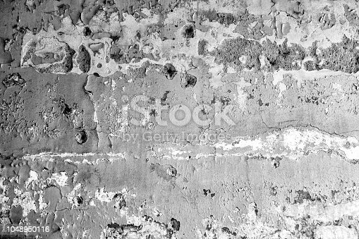 Thorn, destroyed and ruined wall with hole thats look like bullet holes, black and white processed