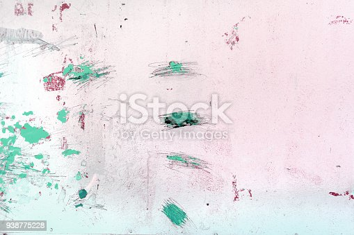 istock A wall with incomprehensible scratches, blots and divorces. An unusual white background with spots of green paint. 938775228