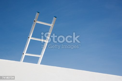 istock Wall with ladder and blue sky 74180734