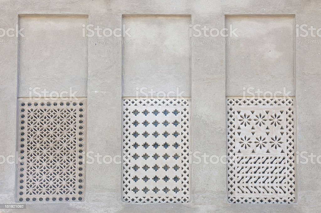 Wall with ornamented windows in traditional arabic architectural style stock photo