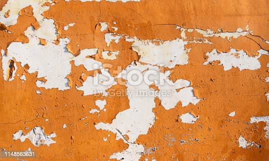 Wall with peeled paint background.