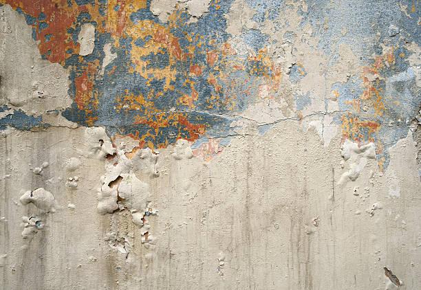 wall with peeling paint - adomer stok fotoğraflar ve resimler