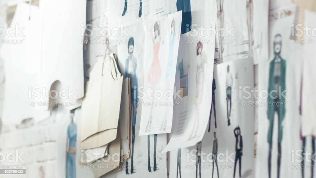 Wall with Pinned Fashion Drawings and Sketches, Templates Hanging on the Wall. stock photo