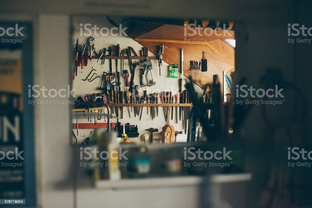 Wall with tools seen in mirror - Photo