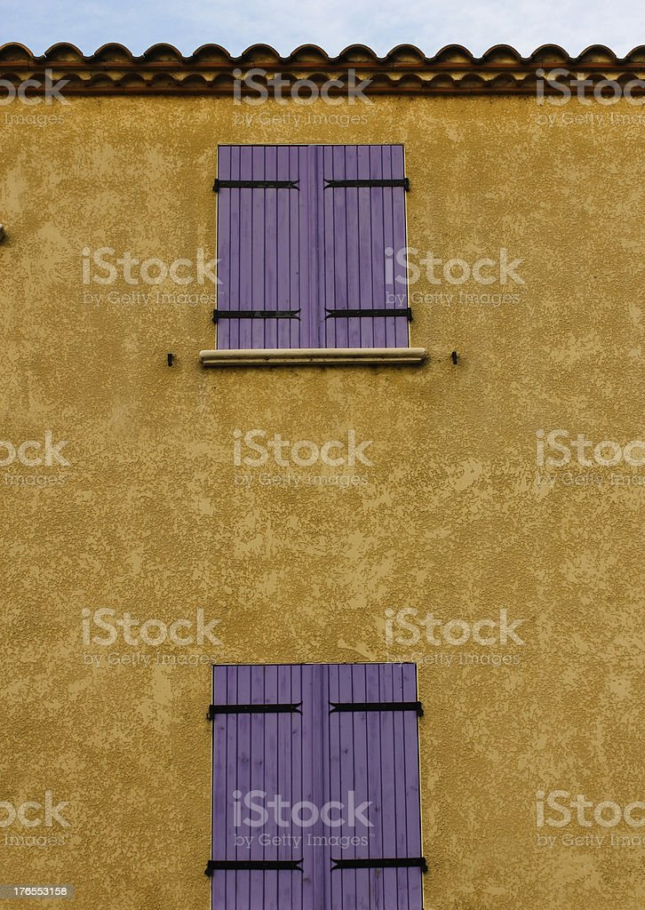 Wall with two violet shutter royalty-free stock photo