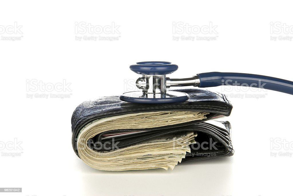 Walled and cash being examined with stethoscope royalty-free stock photo