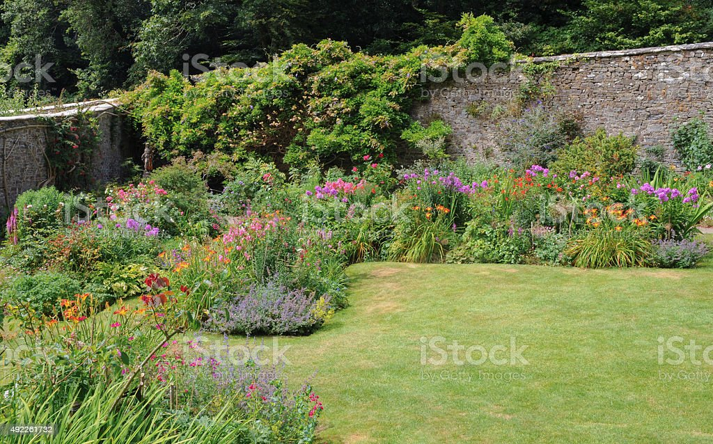 Walled Garden, Full of Summer Flowers, and with Wisteria on the Wall...