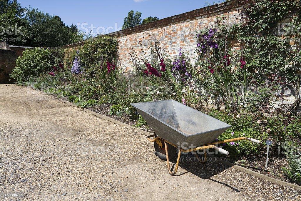 Walled Garden with Wheelbarrow stock photo