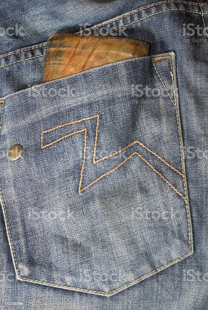Wallet in a jeans pocket stock photo