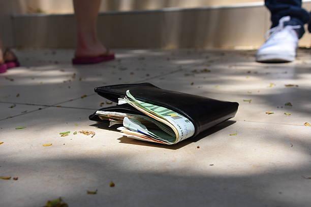 wallet lying on the floor stock photo