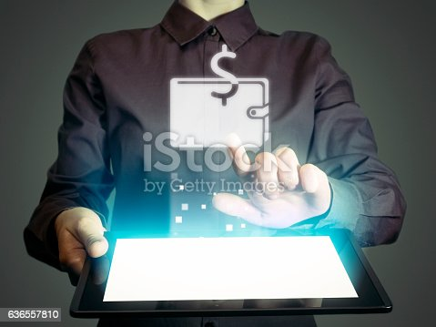 Image of a girl with a tablet in hands. She touches purse icon. online wallet concept, storage, online banking