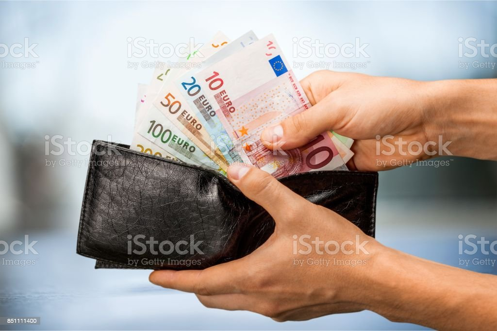 Pulling money out of wallet, close-up view