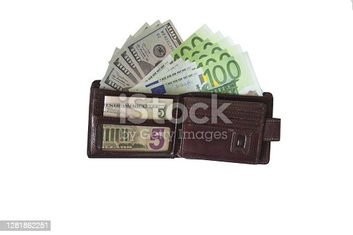 Wallet with dollars and euros on a white background. Wallet with different money on a white.
