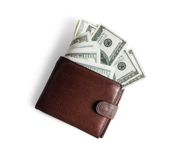 Wallet with dollars Brown leather wallet with dollars on white paper background. Flat lay. wallet money stock pictures, royalty-free photos & images