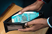 istock wallet with full of Indian currency note. 1193871535