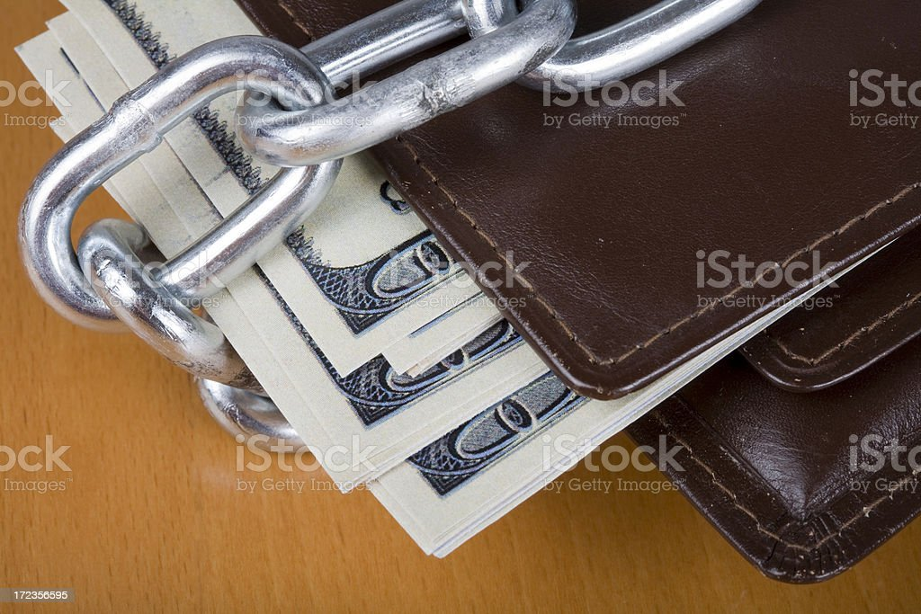Wallet with money and chain royalty-free stock photo