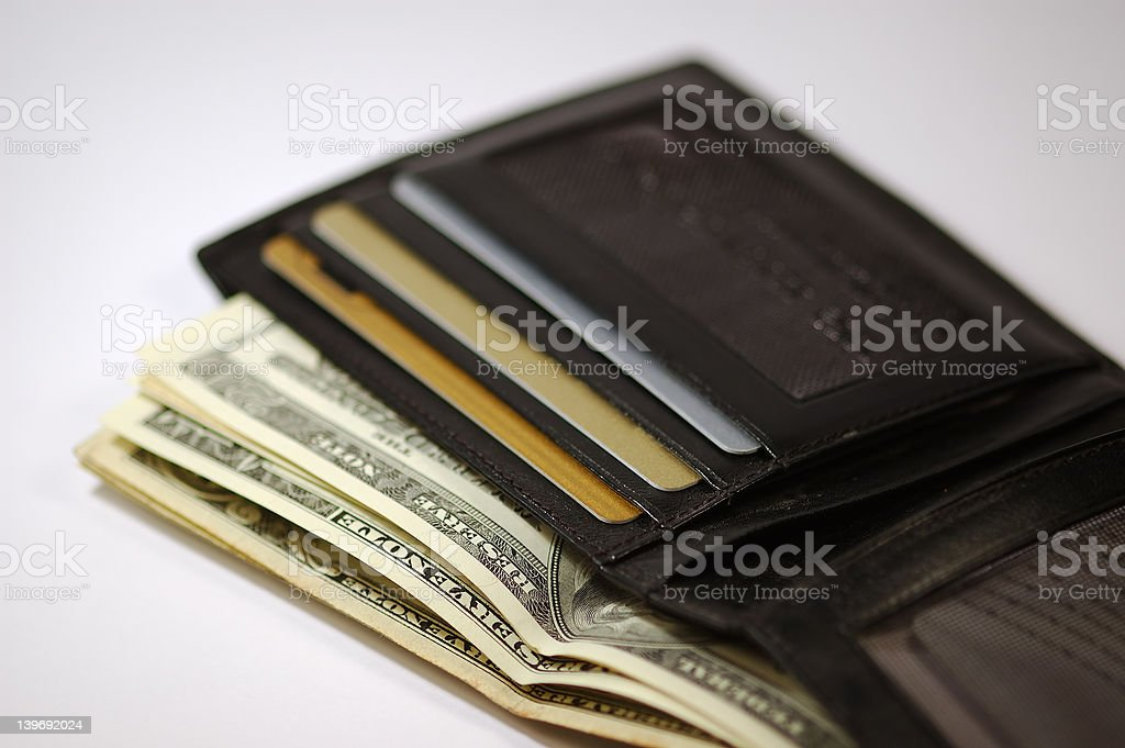 Wallet with money and credit cards royalty-free stock photo