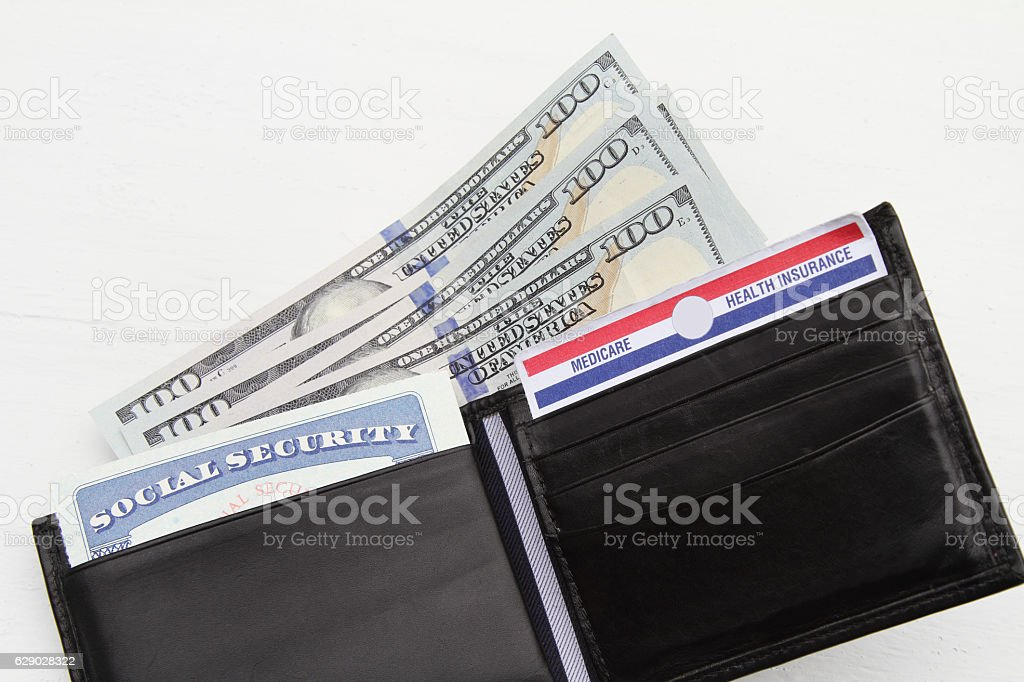 Wallet with social security and Medicare cards and  currency stock photo