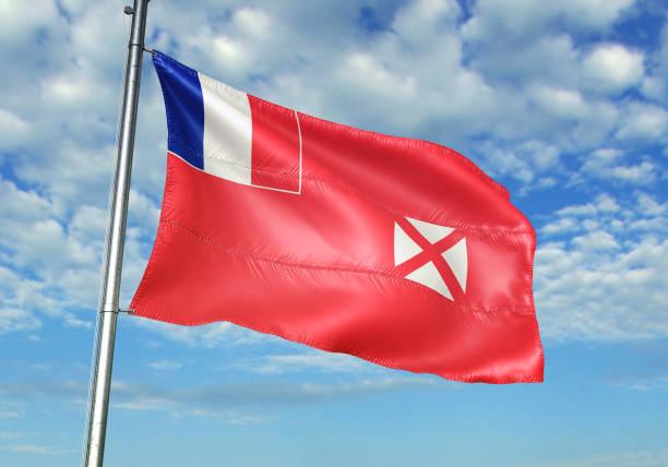 Wallis and Futuna flag waving cloudy sky background stock photo