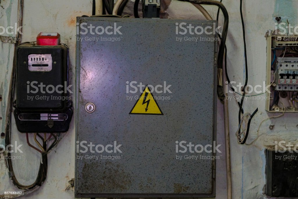 Wall-mounted electric board with electric meter. stock photo