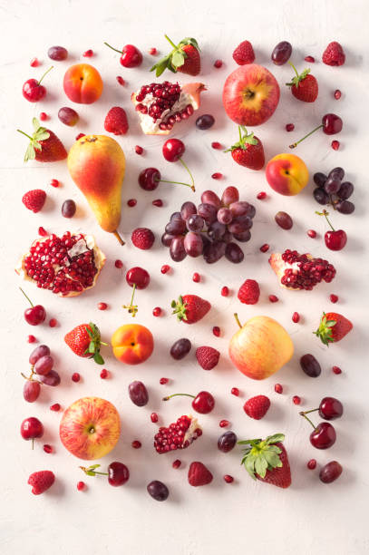 Wallpaper abstract composition of fruits. Red food pattern. Healthy food concept, top view. stock photo