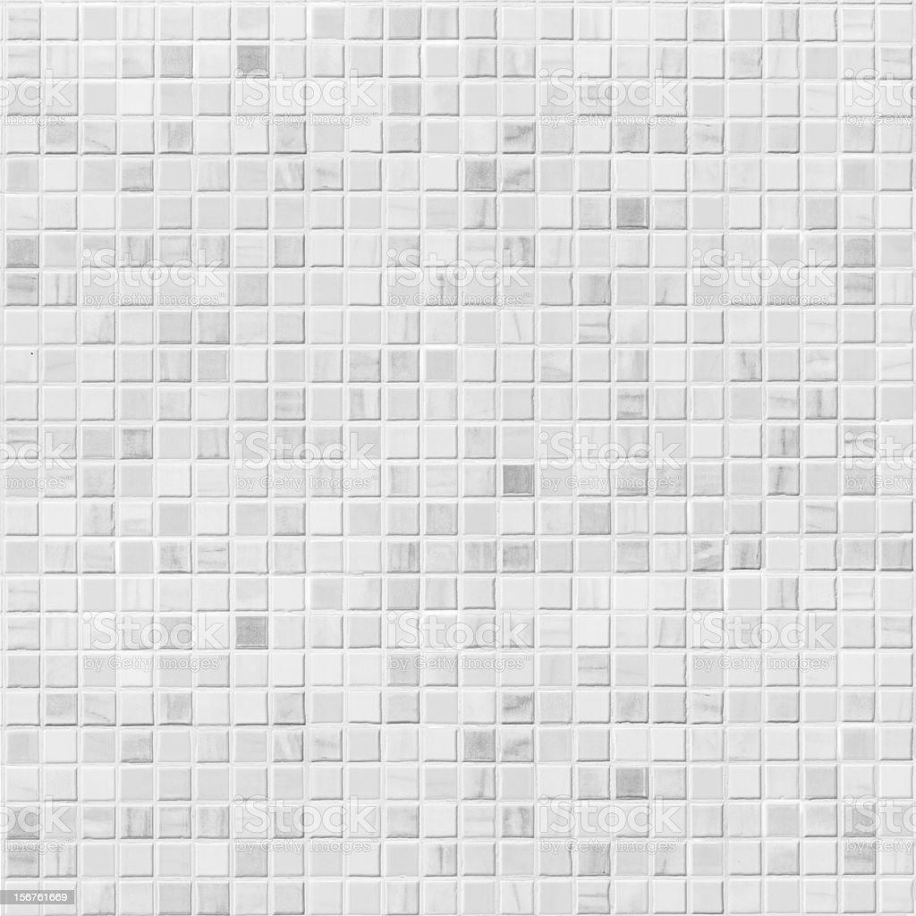 Wallpaper of light grey square tile wall stock photo