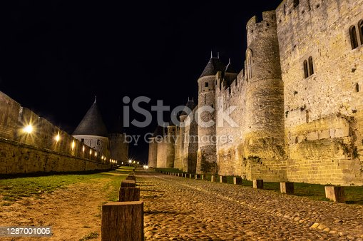 Walls and towers of medieval city of Carcassonne at night, France