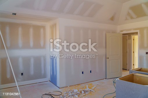 istock walls plasterboards with room under construction 1131042951