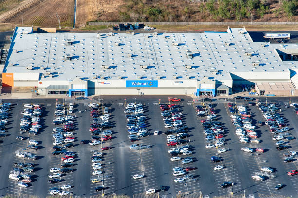 Wal-Mart Aerial Houston, United States - December 10, 2018:  The exterior and store sign of a Wal-Mart warehouse wholesale outlet located just outside Houston, Texas shot from an altitude of about 1500 feet. wal mart stock pictures, royalty-free photos & images