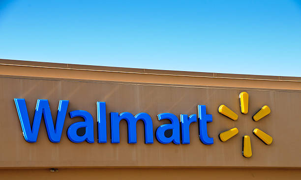 "Walmart  Corporate Logo ""Bellingham, Massachusetts, USA  September 2, 2011:New Walmart corporate identification name and logo outside a store in Bellingham, Massachusetts. Logo was changed from previous design in Summer 2008"" wal mart stock pictures, royalty-free photos & images"