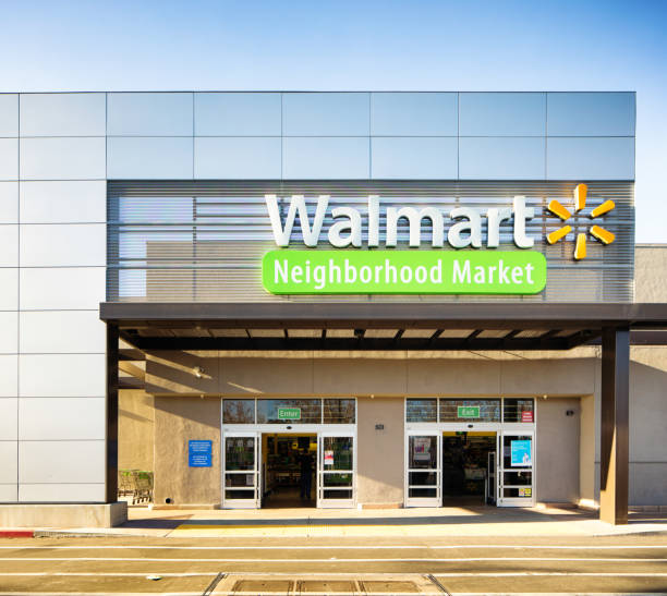 Walmart Neighborhood market store entrance facade with sign Walmart Neighborhood market store entrance facade with sign, photographed in San Jose, California on boxing day. wal mart stock pictures, royalty-free photos & images