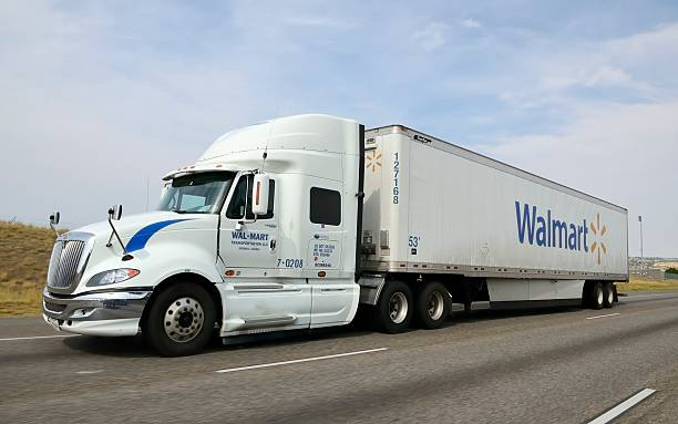 Walmart Denver, Colorado, USA - September 23, 2012: A Walmart truck on I-25 outside of Denver, Colorado. Founded by Sam Walton in 1962, Walmart is the world's largest retailer, and the largest corporation in the world according to 2011 revenues of over $421 Billion. wal mart stock pictures, royalty-free photos & images