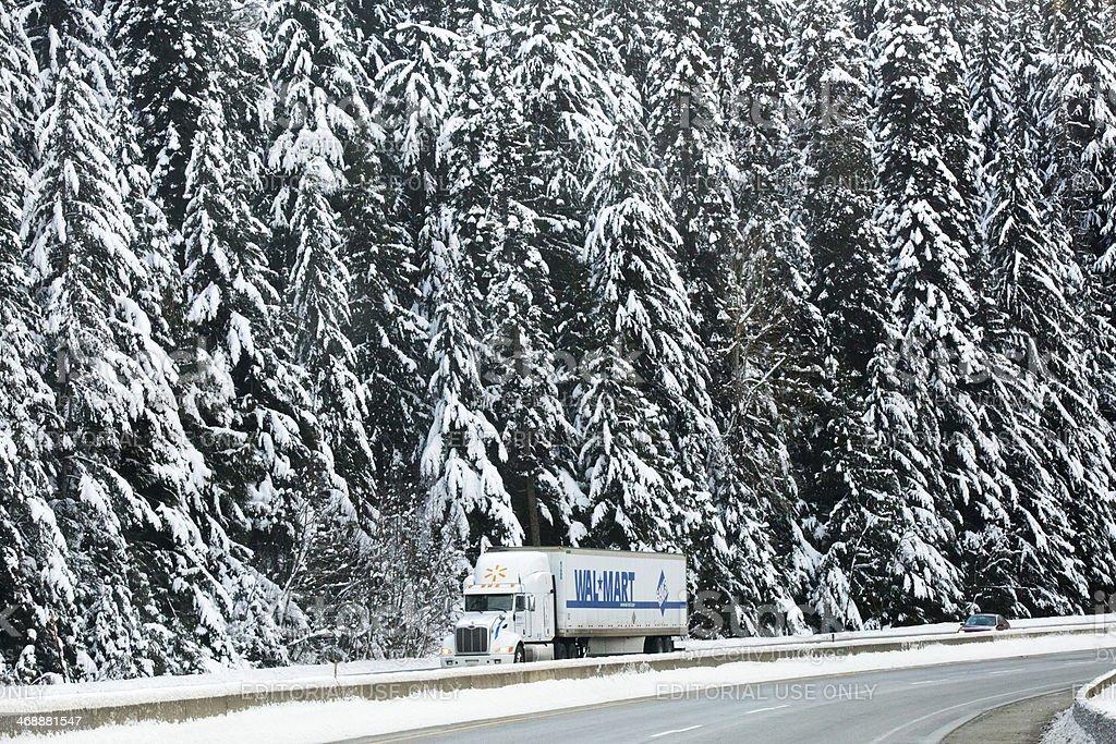 Walmart Semi-Truck Transporting Goods Through Idaho Forest stock photo