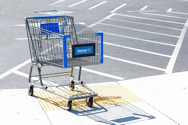 "Walmart shopping cart. ""Sacramento, USA - September 13, 2013: Walmart shopping cart on September 13, 2013 in Sacramento, California. Walmart is an American multinational retail corporation that runs chains of large discount department stores"" wal mart stock pictures, royalty-free photos & images"