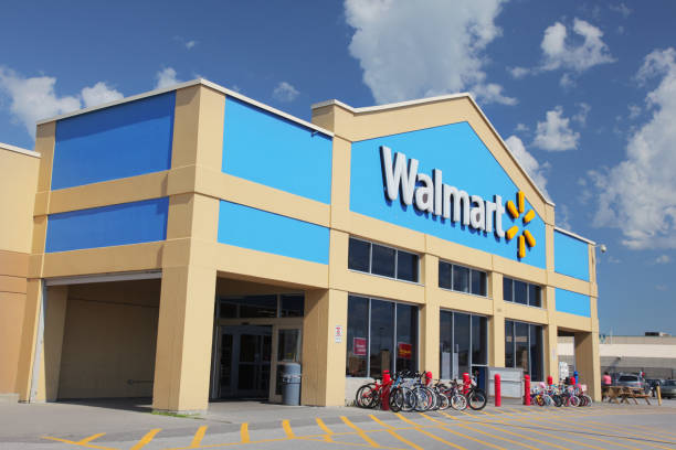 "Walmart Store Building Exterior ""Sainte-Hyacinthe, Canada - June 30, 2012: The front facade and entry doors to a Walmart store in Canada. Wal-Mart Canada Corp. is the Canadian unit of Walmart and was founded in 1994 in Mississauga, Ontario with the purchase of the Canadian Woolco stores from Woolworth Canada."" wal mart stock pictures, royalty-free photos & images"