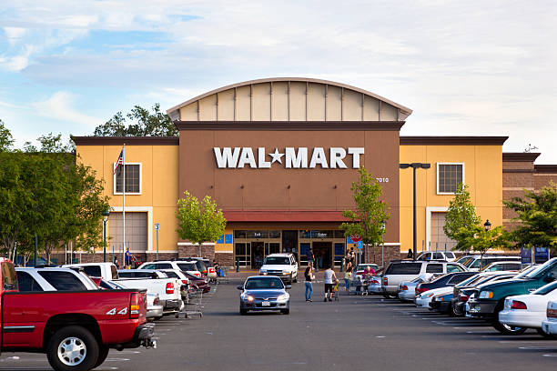 Wal-Mart Supercenter Citrus Heights, California, USA - May 20, 2011: View at a California Walmart storefront from its parking lot. Walmart is an American public multinational corporation that runs chains of large discount department stores and warehouse stores. wal mart stock pictures, royalty-free photos & images