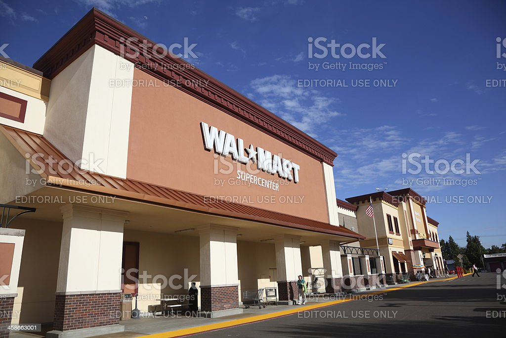 WalMart Supercenter Orangevale, California, USA - May 11, 2011: California Walmart storefront on a sunny spring afternoon. Walmart  is an American public multinational corporation that runs chains of large discount department stores and warehouse stores. Building Exterior Stock Photo
