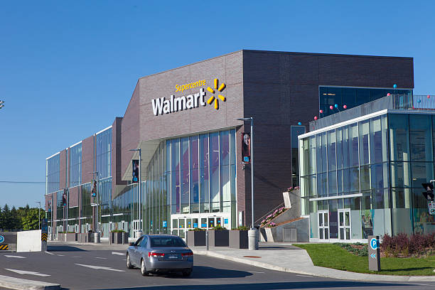 walmart supercenter Montreal,Quebec, Сanada - September 19, 2014: walmart store front.Walmart is an American public multinationnal corporation stores and warehouse stores. wal mart stock pictures, royalty-free photos & images