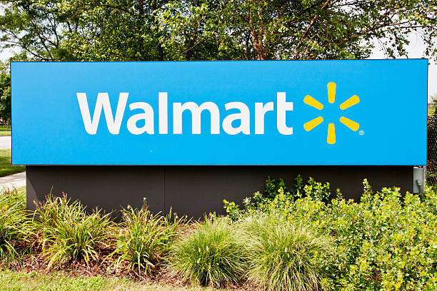 Walmart Supercenter Sign Mount Prospect, IL, USA - August 6, 2011:  Sign outside a Walmart Supercenter.  Walmart is a large discount department and grocery store chain founded in 1962 by Sam Walton. wal mart stock pictures, royalty-free photos & images
